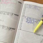 Hausaufgabenheft mit Füller